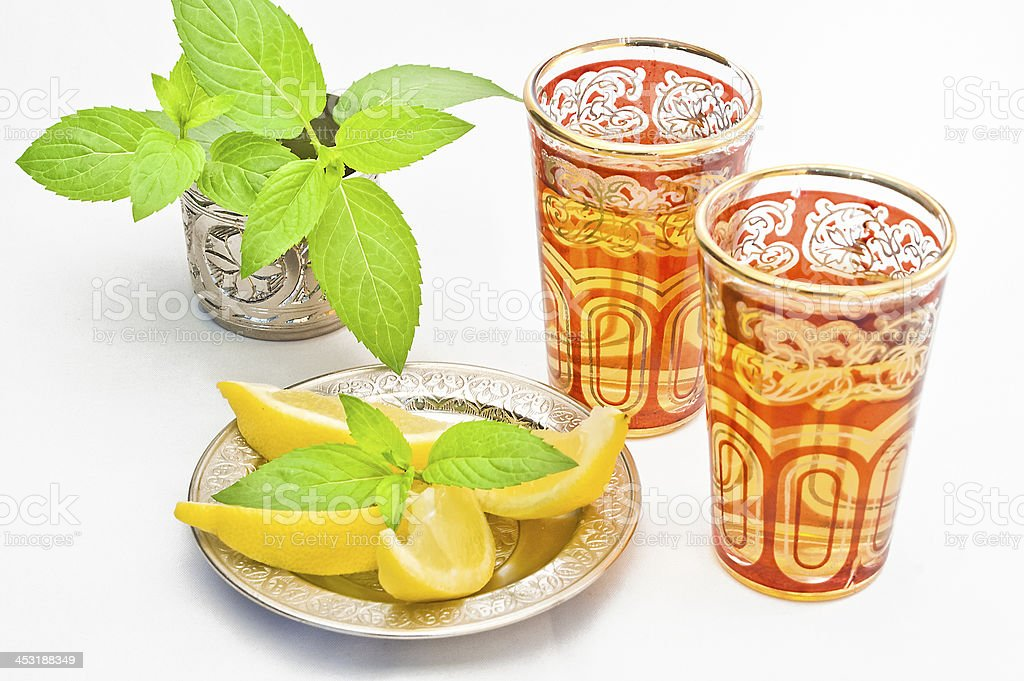 Moroccan tea with lemon and mint stock photo