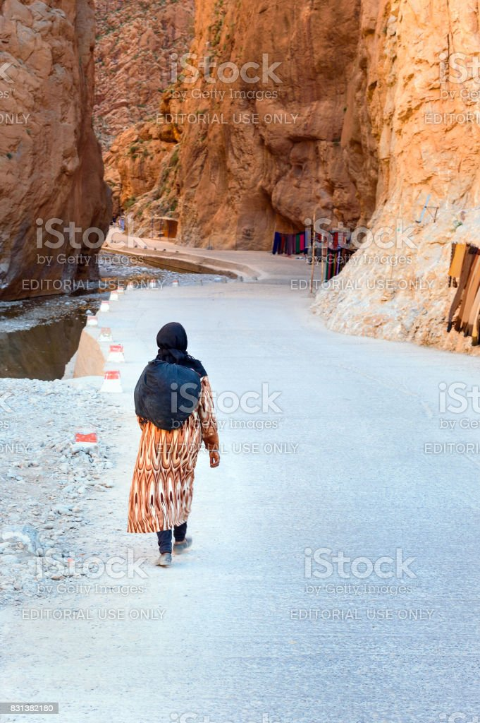 Moroccan woman goes to Todgha Gorge in Morocco stock photo