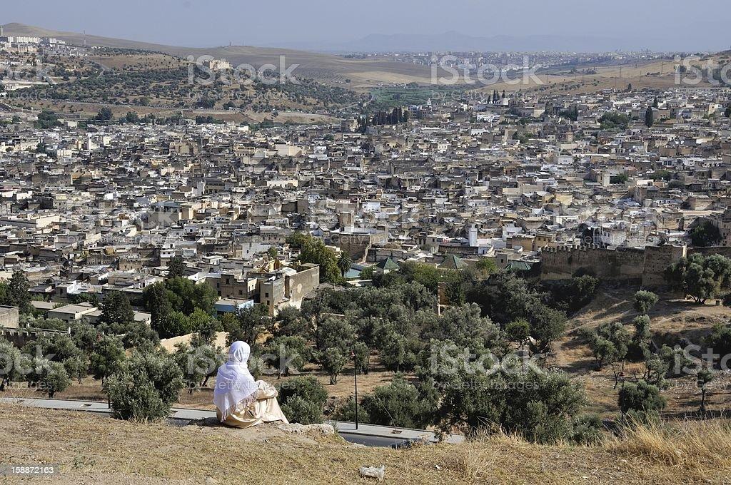 Moroccan woman in golden djellaba and white hijab stock photo