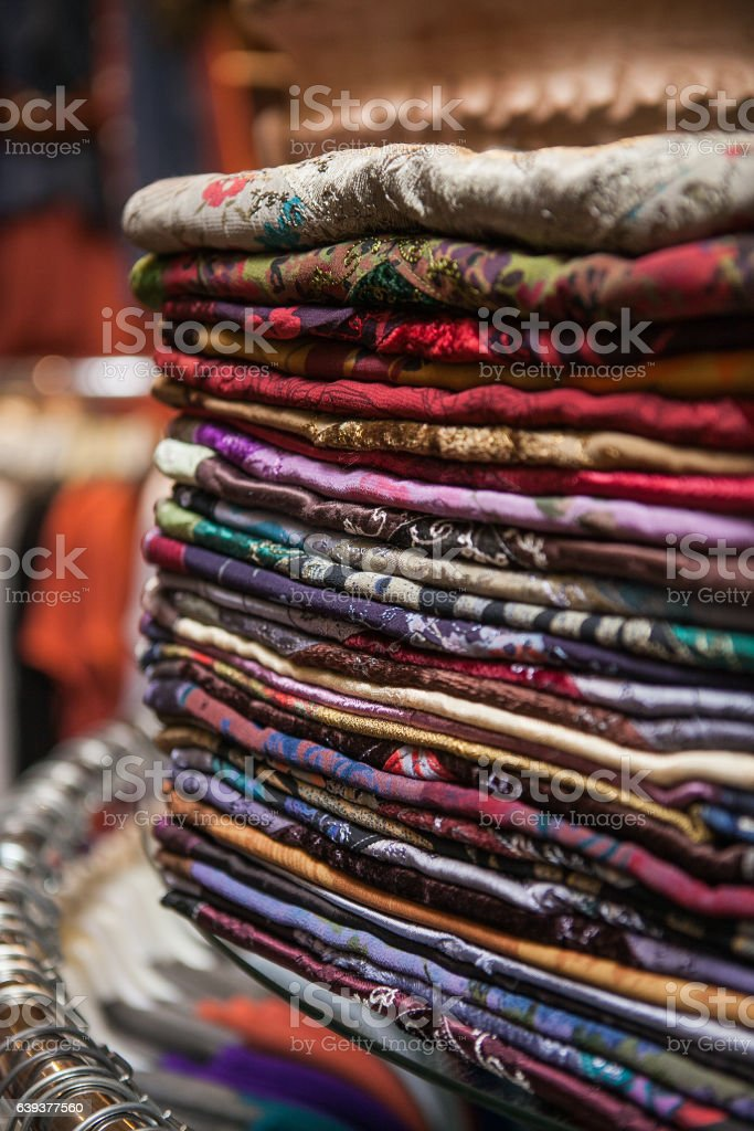 Moroccan women's bright colorful clothes at a market stock photo