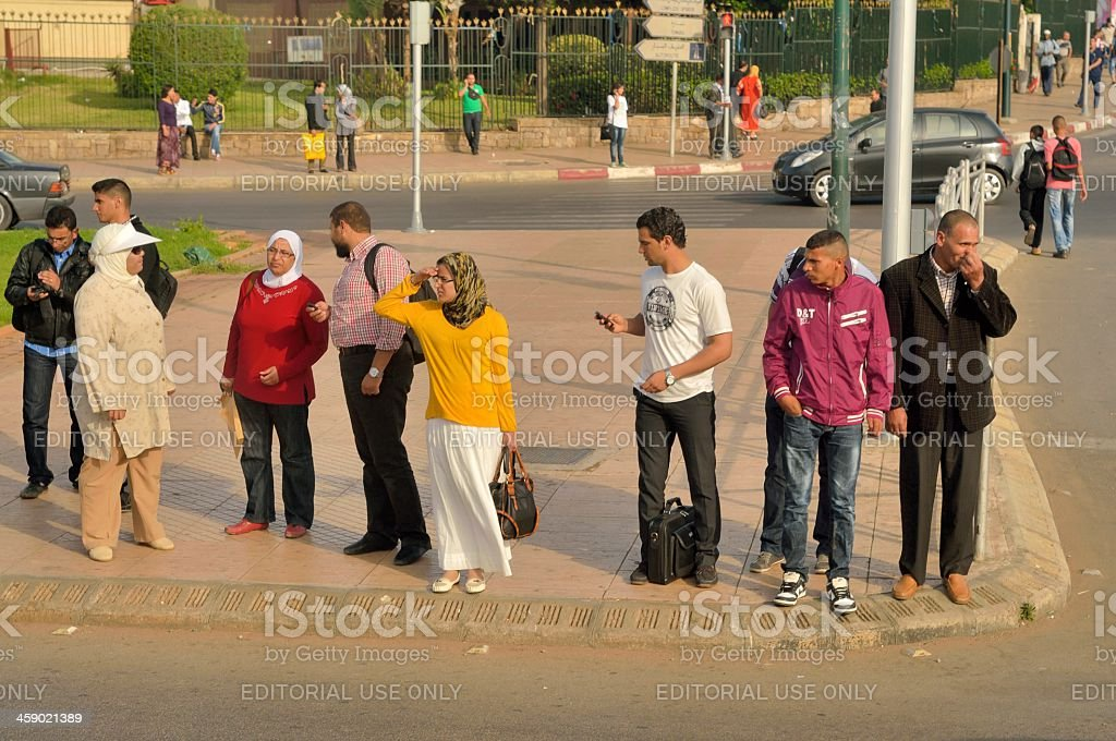 Moroccans At Bus Stop stock photo