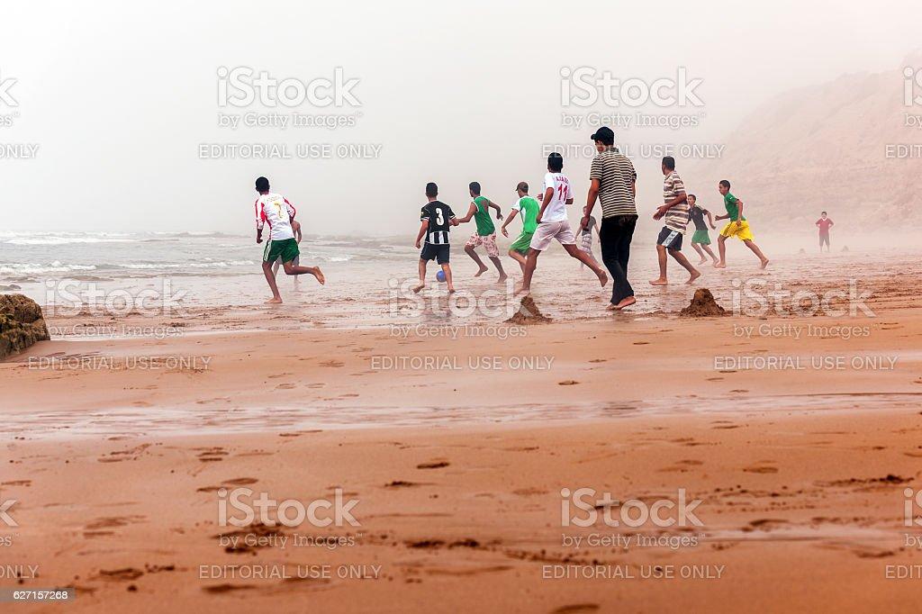 Moroccans Playing Soccer , Atlantic Coast,Morocco stock photo
