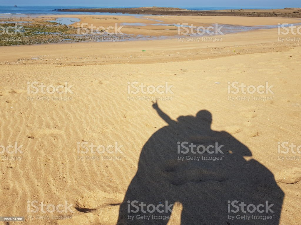 Morocco - beach shadow lovers stock photo