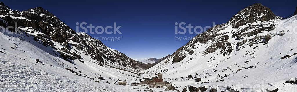 Morocco High Atlas mountains Mt Toubkal refuge winter panorama Africa stock photo