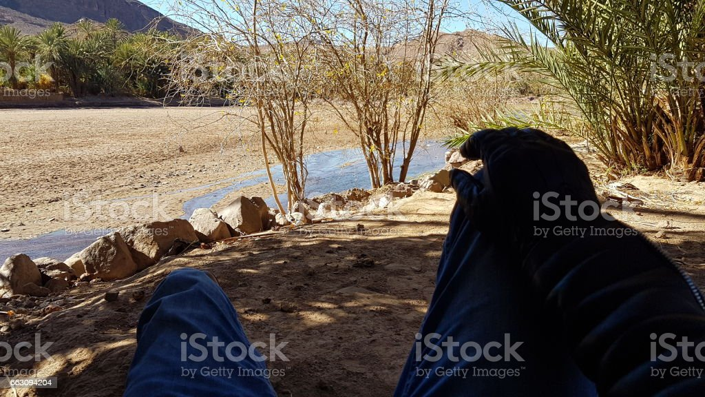 Morocco - traveler rest at Fint south stock photo