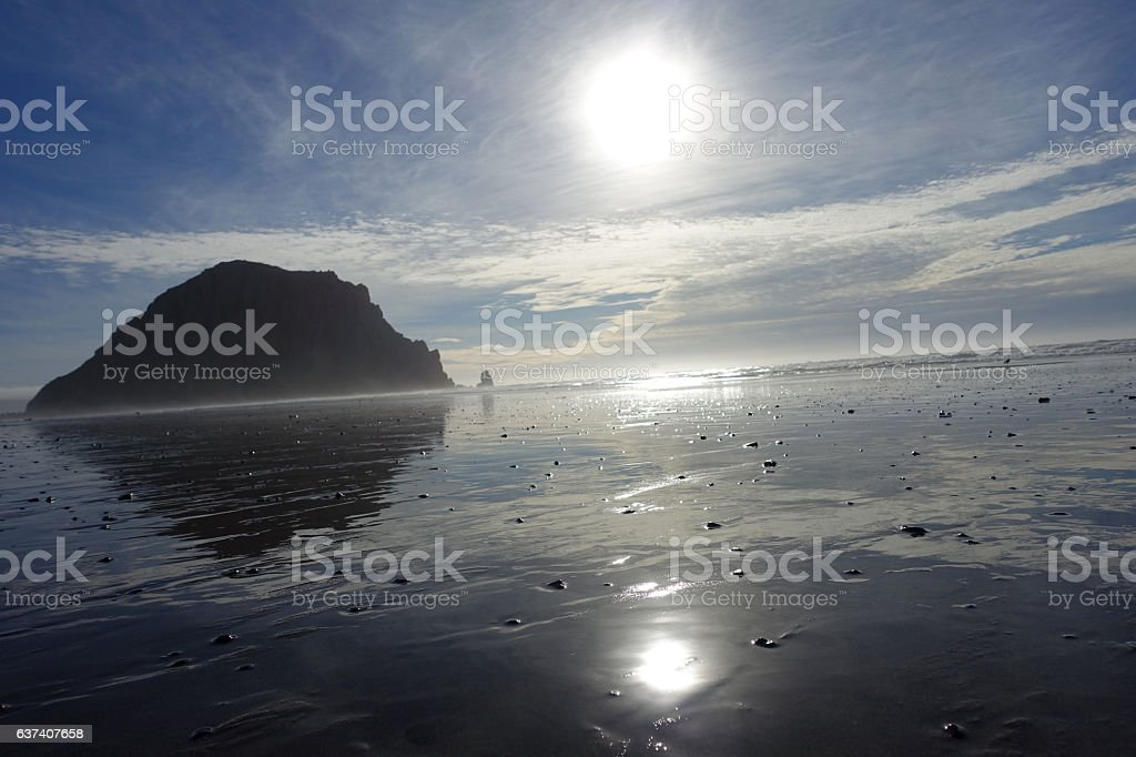Morro Rock & Beach with Sun Reflecting off of Wet Sand stock photo