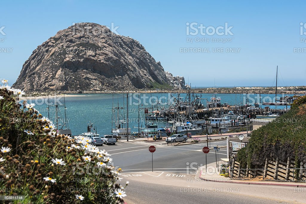 Morro Rock in the harbor of Morro Bay, California stock photo
