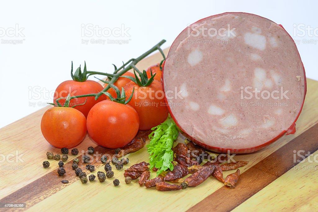 Mortadella Bologna and vegetables stock photo