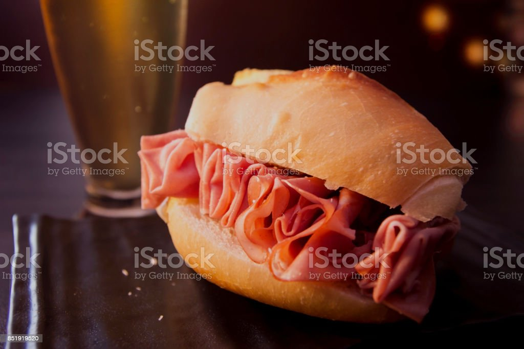 Mortadella sandwich and beer stock photo