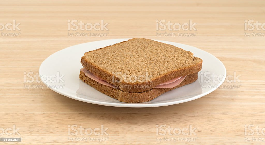Mortadella sandwich on wheat bread stock photo