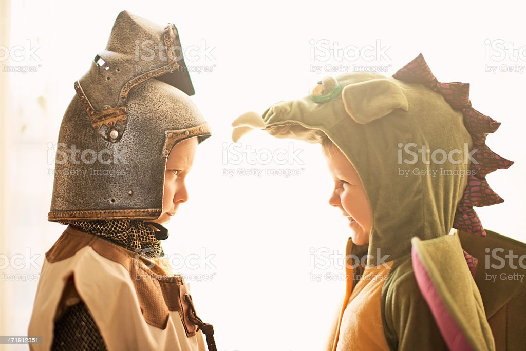 Mortal enemies - knight and dragon. stock photo