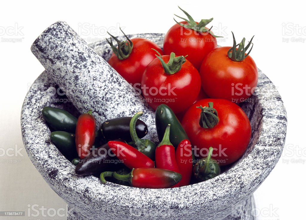 Mortar and Pestle, Pre-Salsa tomatos, peppers stock photo