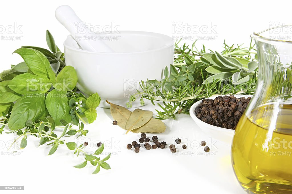 Mortar and Pestle with Fresh Herbs stock photo
