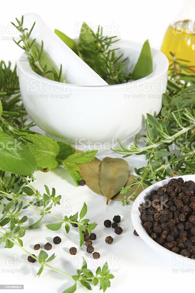 Mortar and Pestle with Fresh Herbs royalty-free stock photo