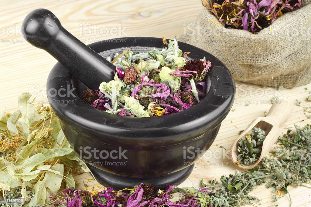 mortar and pestle with healing herbs royalty-free stock photo