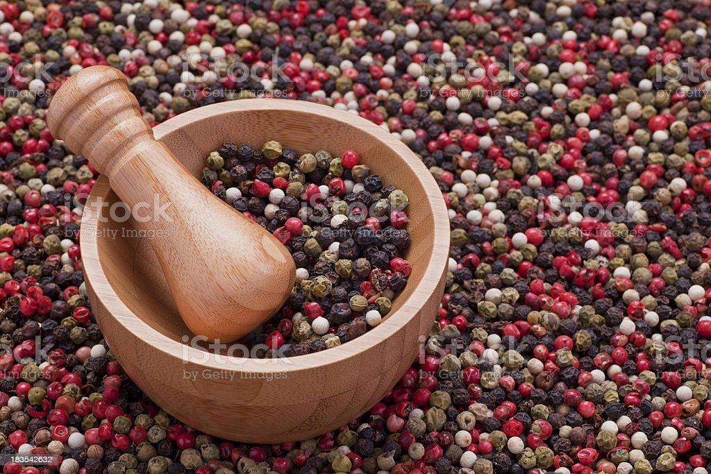 Mortar and pestle with mixed peppercorns royalty-free stock photo