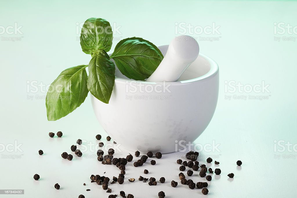 Mortar with basil and pepper royalty-free stock photo