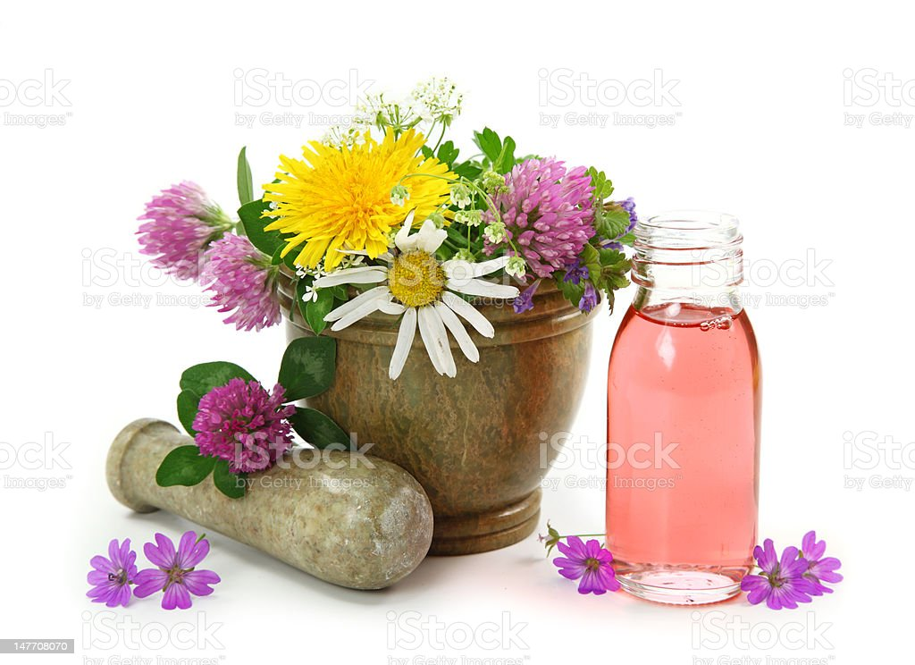 Mortar with fresh flowers and essential oil royalty-free stock photo