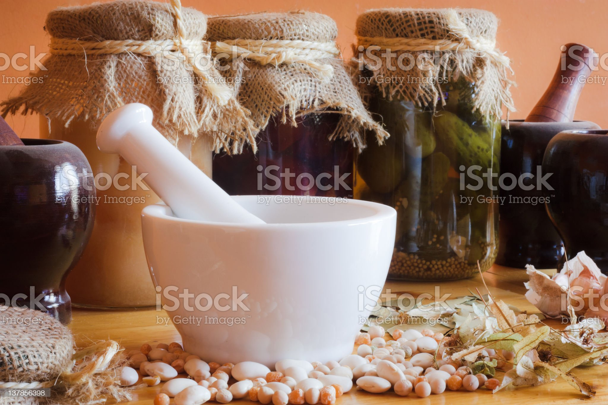 Mortar with herbs in larder royalty-free stock photo