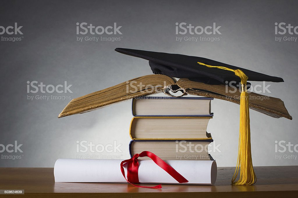 mortarboard and graduation scroll royalty-free stock photo