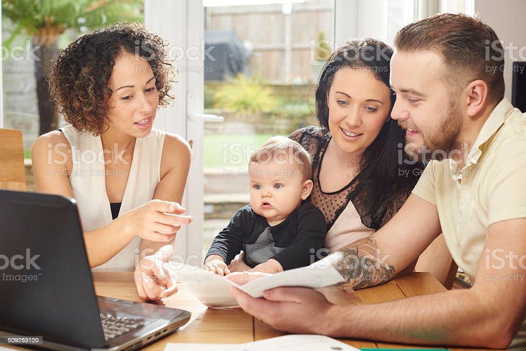 mortgage advisor explaining the small print. stock photo