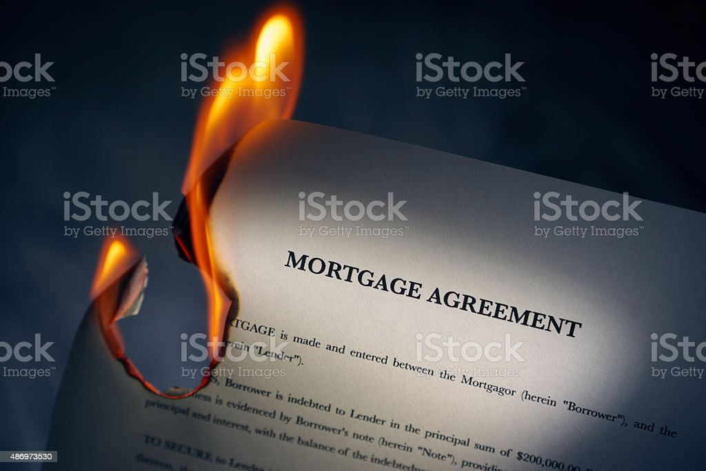 Mortgage Agreement Contract Burning On Fire stock photo