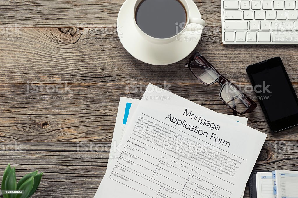 Mortgage  application form on wooden table. stock photo
