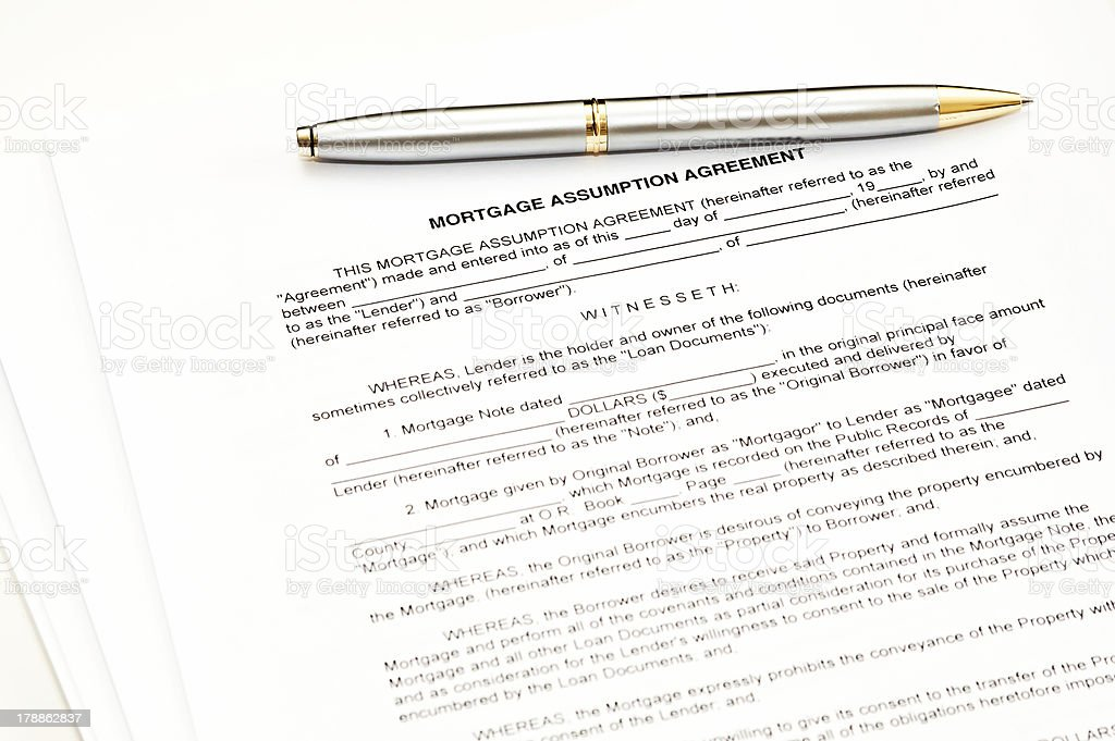 Mortgage assumption agreement with a pen for signature royalty-free stock photo