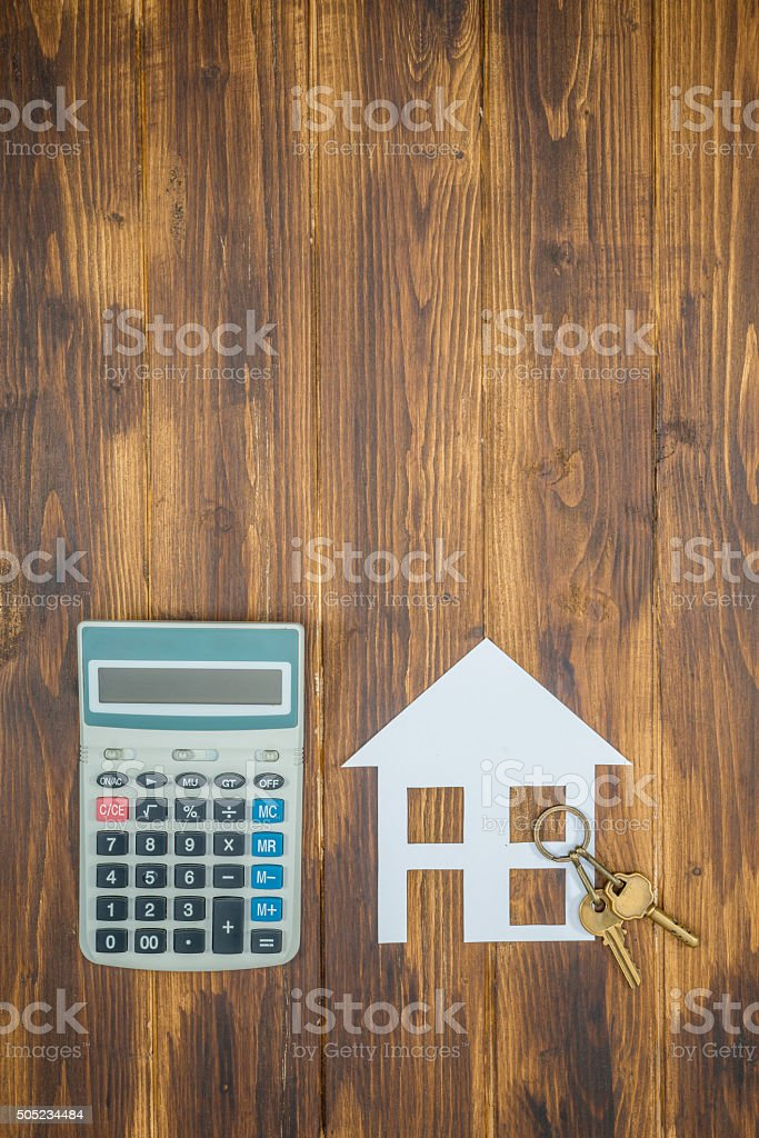 Mortgage Calculator, house and key with Calculator stock photo