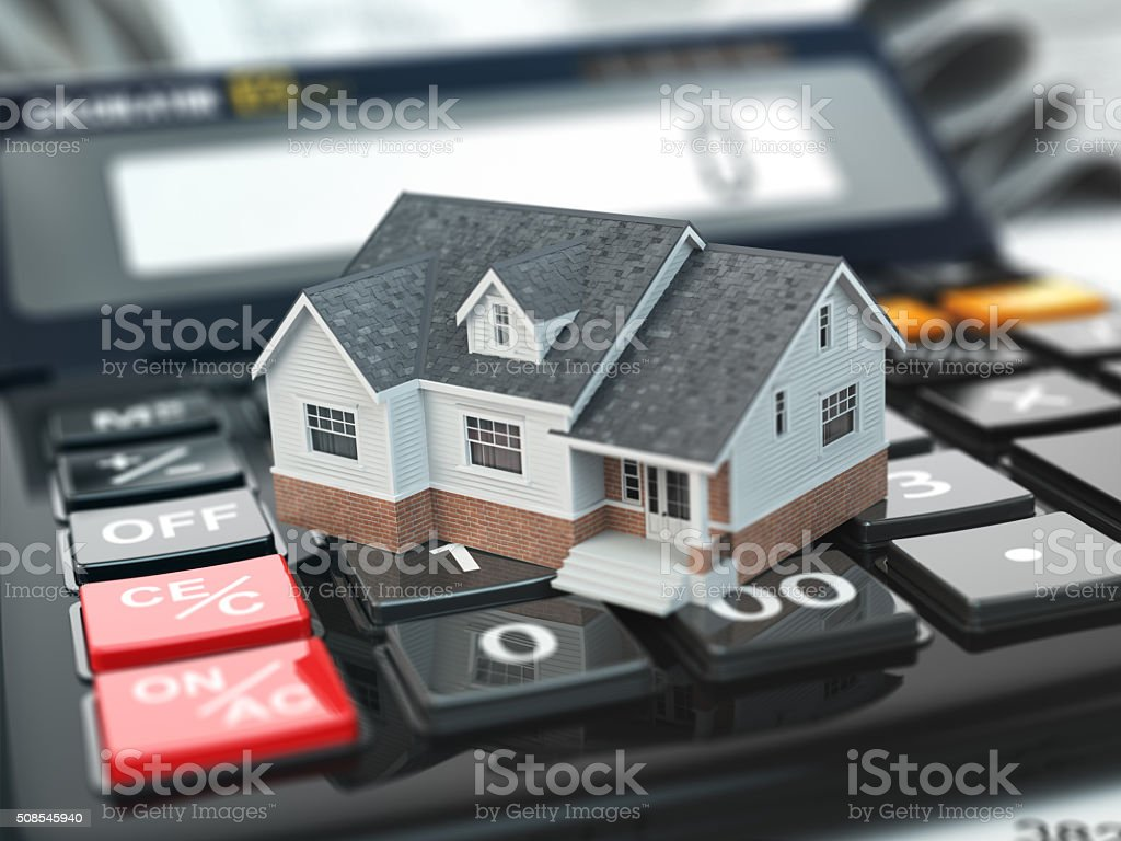 Mortgage calculator. House on buttons. Real estate concept. stock photo