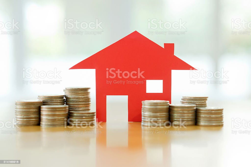 Mortgage concept by money house from the coins stock photo