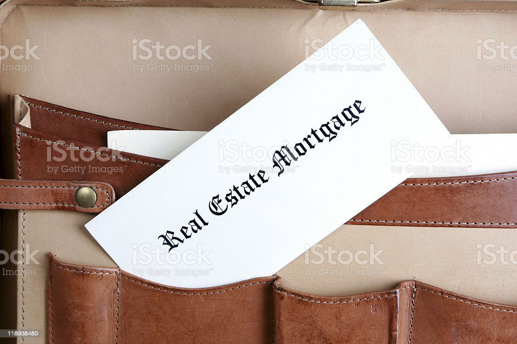 Mortgage documents in a leather broefcase royalty-free stock photo
