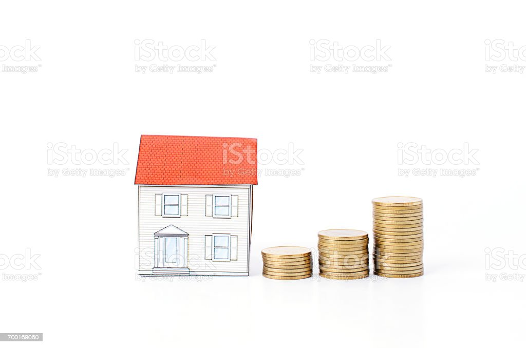 Mortgage loans concept with Coins stack Isolated on white backgrounds stock photo