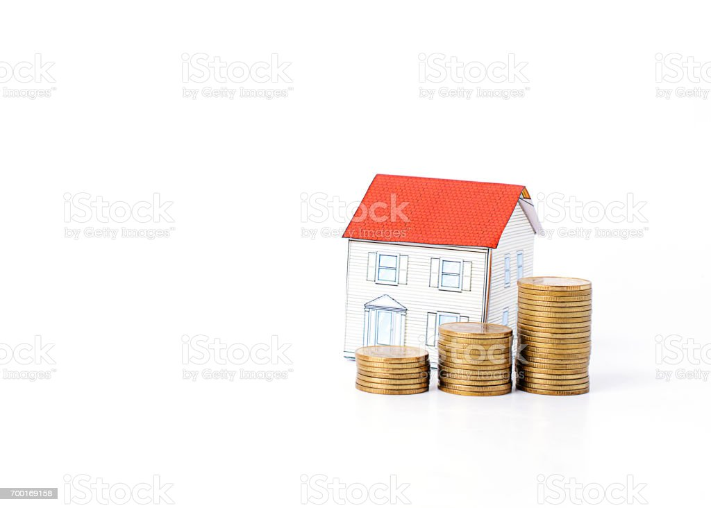 Mortgage loans concept with money coins stack and paper house Isolated on white backgrounds stock photo