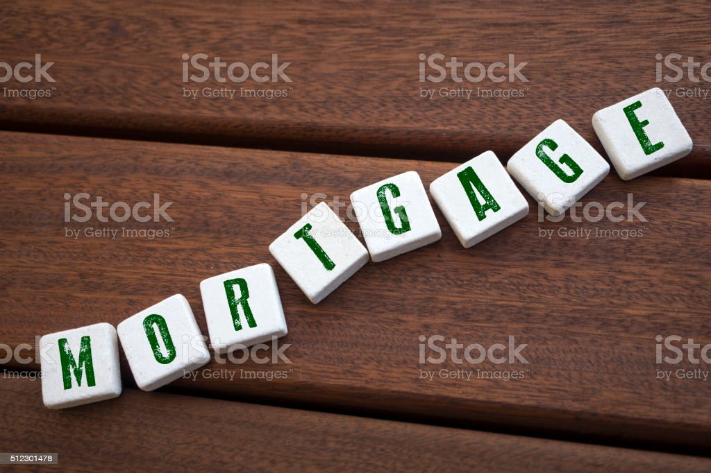 Mortgage , Word with Alphabet Blocks stock photo