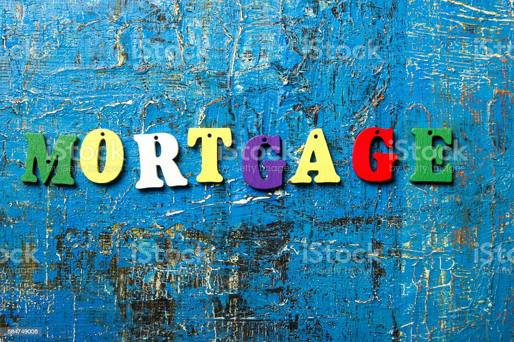 Mortgage word written of colorful wooden abc letter on abstract stock photo