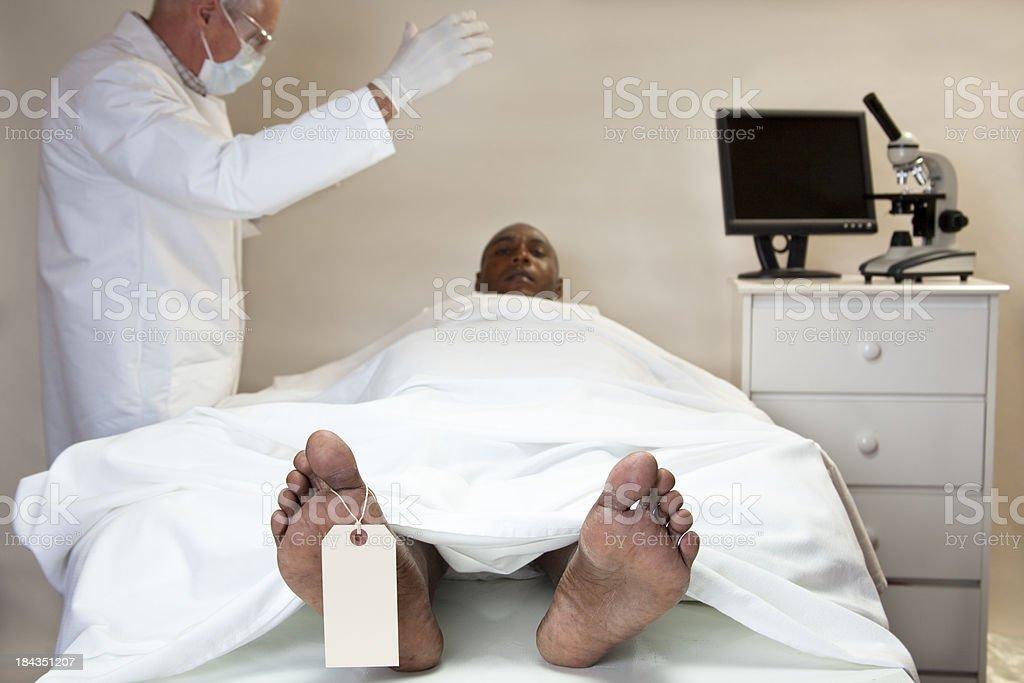 Mortician surprised as dead man rises in morgue stock photo