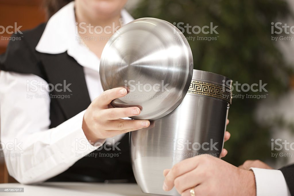mortician with client comforting and advising stock photo