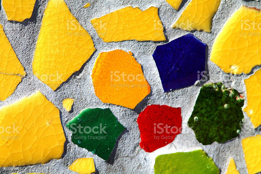 Mosaic from broken ceramic colorful tiles. stock photo