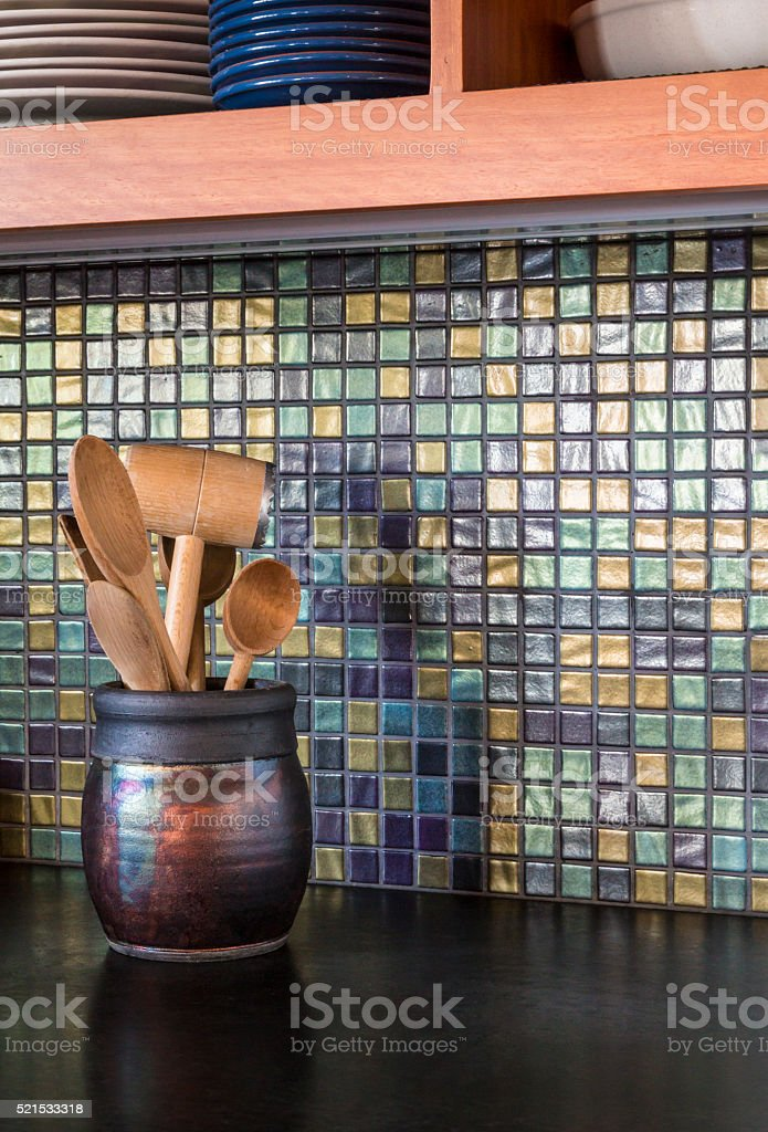 Mosaic glass tile backsplash in contemporary upscale home kitchen interior stock photo