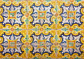 Mosaic of colorful ceramic tiles with floral style