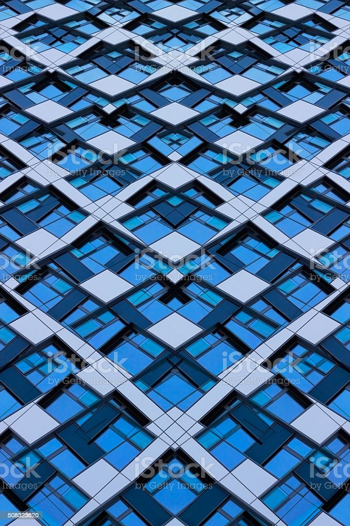 Mosaic pattern obtained by double exposition of glass facade fragments stock photo
