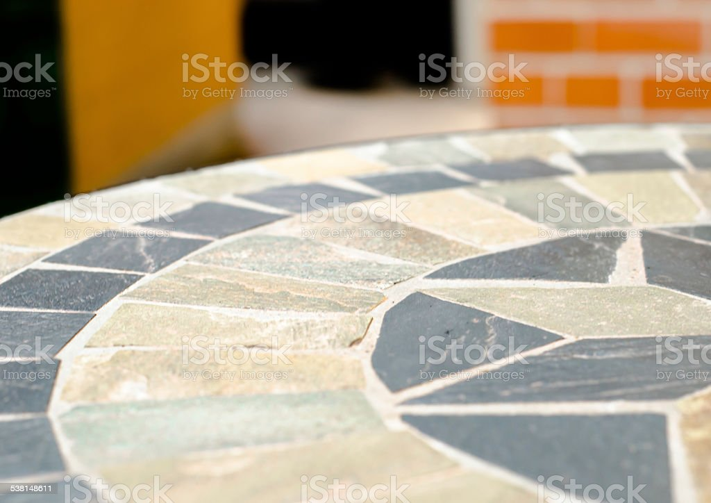 mosaic table stone at coffee shop in garden stock photo