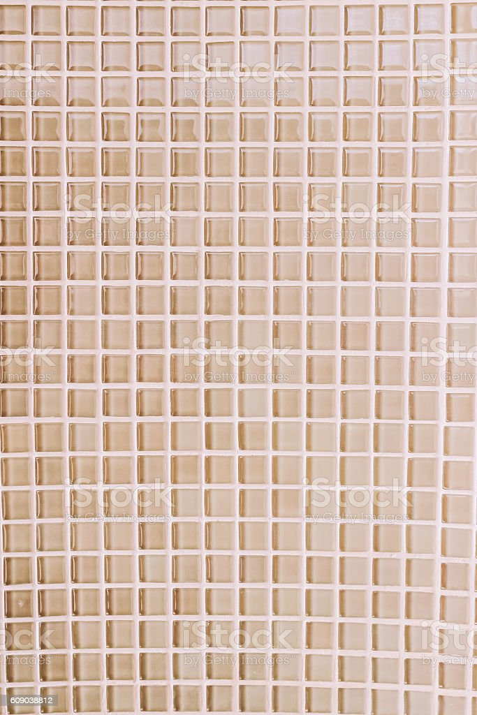 Mosaic tile on bathroom wall with warn white light effect stock photo