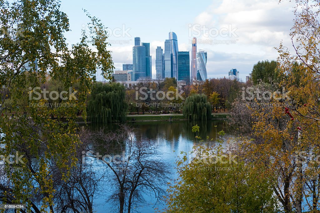 Moscow City Skyscraper through the trees and pond stock photo