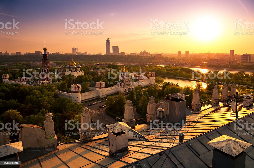 Moscow cityscape at sunset. View from roof of old building stock photo