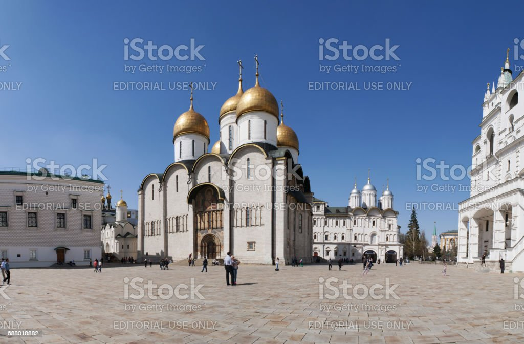 Moscow Kremlin, Russia, 04/29/2017: groups of tourists in the Cathedral Square (Sobornaya Square), the main square of the complex, site of solemn coronation and funeral of the Russian czars stock photo