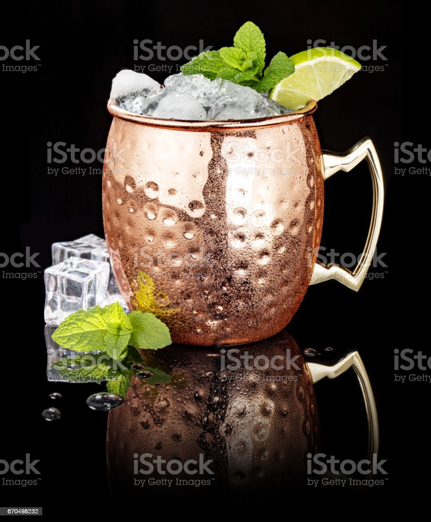 Moscow Mule in a copper cup on black background stock photo