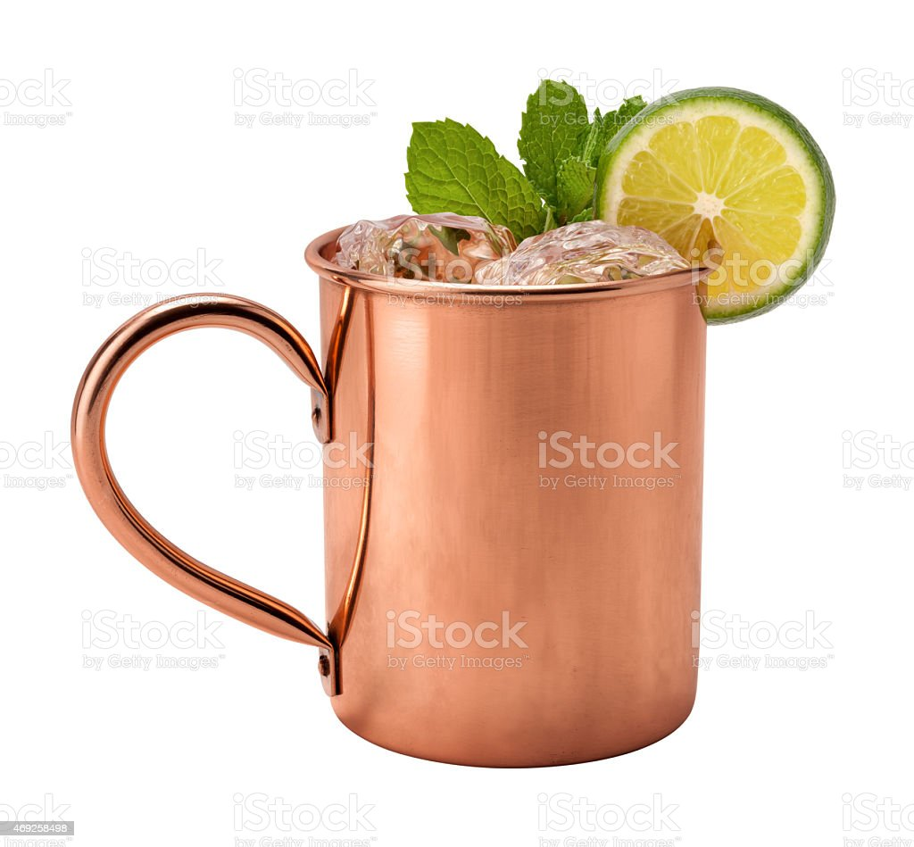 Moscow mule with mint and lime garnish in a copper mug stock photo