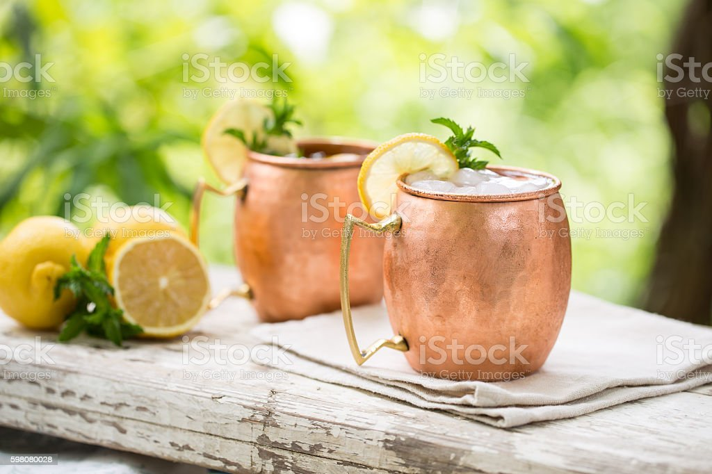 Moscow mules cocktail in copper mugs stock photo